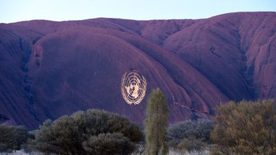 The United Nations crest was projected onto Uluru. (AAP)