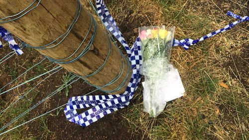 Flowers were laid for the woman at the scene. (Madeline Slattery)