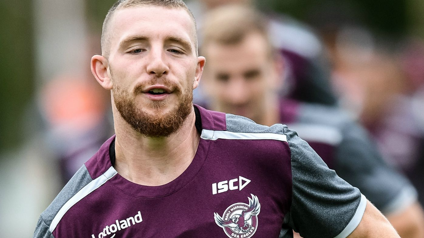 Manly-Warringah Sea Eagles player Jackson Hastings (centre) is seen warming up during a team training session in Sydney, Tuesday, April 3, 2018.