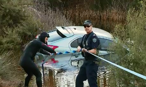 Police spent the afternoon retrieving the submerged Lancer and collecting it as evidence.