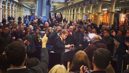 Sir Elton John attracted big crowds at his impromptu performance. (Elton John/ Instagram)