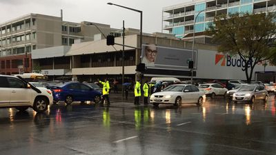 <p>Three police officers direct traffic at an Adelaide intersection following a power outage. (Twitter/@LachlanParker)</p>