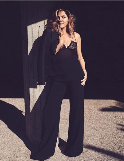 <p>Jennifer Aniston for&nbsp;US <em>InStyle,</em> September 2018</p> <p>The actress wears a Louis Vuitton blazer, Brandon Maxwell pants, Lonely Label bodysuit, Van Cleef &amp; Arpels bracelet and Chopard rings and bracelet.</p>
