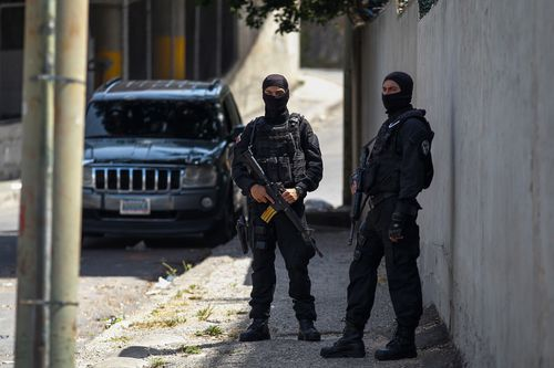 Security agents guard the headquarters of the Bolivarian Intelligence Service (Sebin) also known as Helicoide, as inmates at the crowded detention centre at Helicoide rioted and took control over the facility. Picture: EPA/Helena Carpio