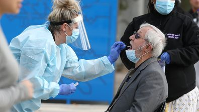 An elderly man gets a COVID-19 test at a testing site at the shopping precinct in the locked down suburb of Dallas on July 02, 2020 in Melbourne, Australia.