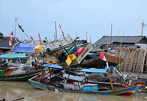 Indonesian boats washed ashore by the tsunami.