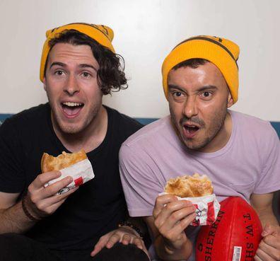 Footy fans eating KFC Zinger Pie
