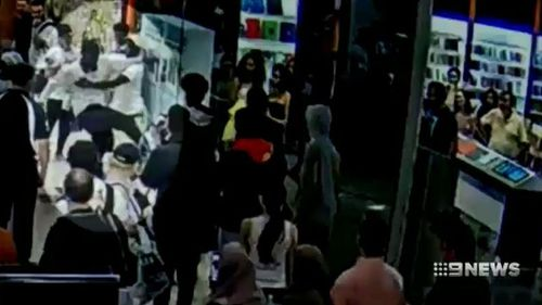 Footage shows an officer being kicked in the face at Highpoint Shopping Centre. (9NEWS)