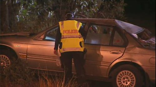 The driver was ejected from the car onto powerlines. Image: 9News