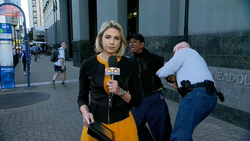 Kriukelis was speaking with the TODAY team when the man was arrested behind her. (9NEWS)