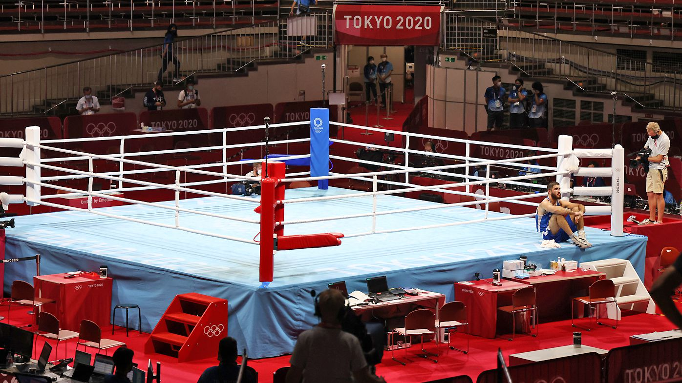 France's Mourad Aliev refuses to leave the ring after he was disqualified for headbutting Team GB's Frazer Clarke