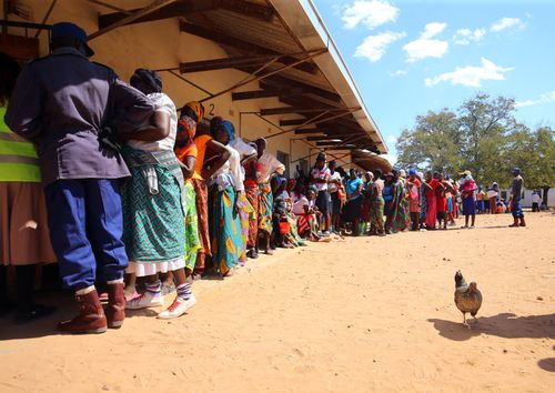 A long queue of women voters in rural Chinyenyetu, outside Harare, Zimbabwe, 30 July 2018. Zimbabweans voted to choose between 23 presidential candidiates and more than 120 parties who have registered to take part in the elections. EPA/AARON UFUMELI