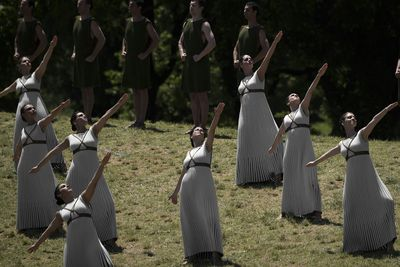 Eleven women, representing the Vestal Virgins, perform a celebration at the Temple of Hera.