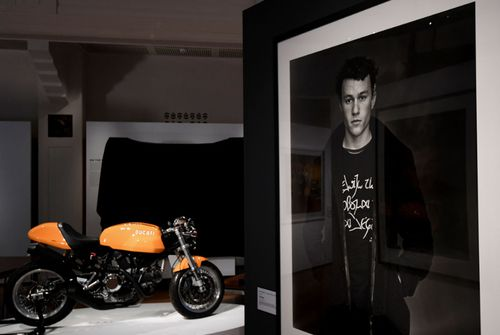 A portrait and the personal motorbike of the late Australian actor Heath Ledger featured in the exhibition.