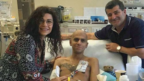 Mr Sylo, pictured with his parents in hospital in the US.