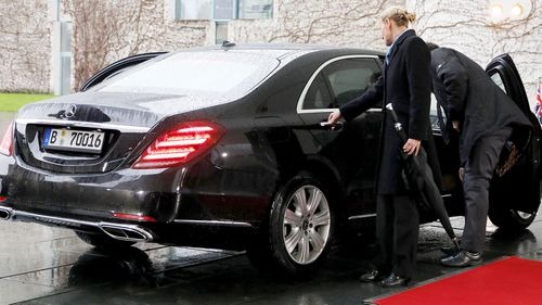 A tense moment for British Prime Minister Theresa May as her car door refuses to open as she arrives to meet German Chancellor Angela Merkel.