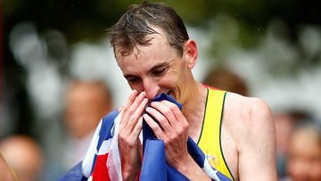 Michael Shelley celebrates after winning the marathon at the Commonwealth Games in Glasgow. (AAP)