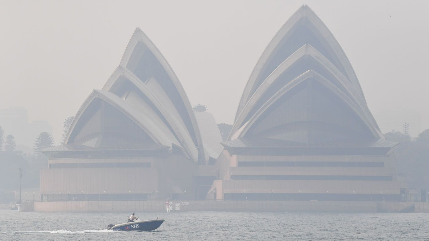 The Opera House is seen with smoke haze which enveloped Sydney Harbour