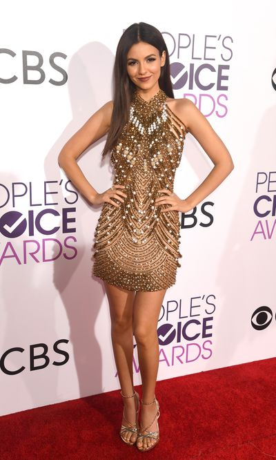 <p>Victoria Justice is perfect in this gold and silver beaded cocktaik dress by Yousef Al-Jasmi.</p> <p>Image: Getty.</p>