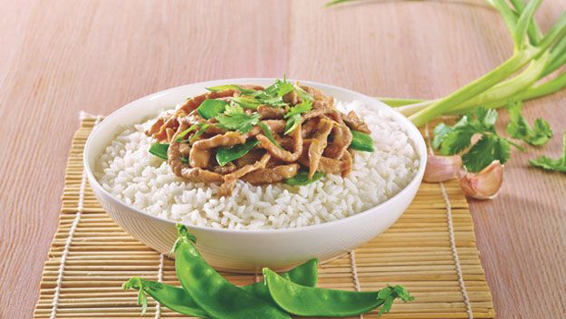 Chinese garlic and ginger pork with rice and snow peas