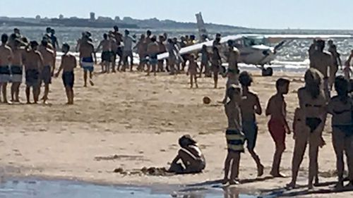 An image shared by local media purports to show the light aircraft forced to make an emergency landing on a beach in Portugal. (Supplied)