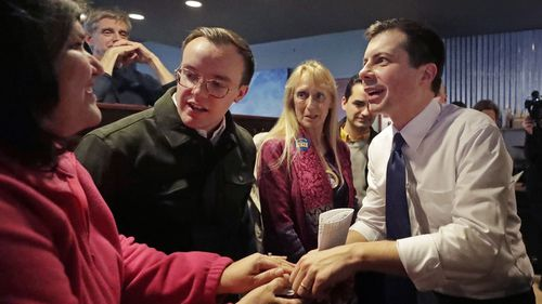 Pete Buttigieg and his husband Chasten greet voters in New Hampshire.