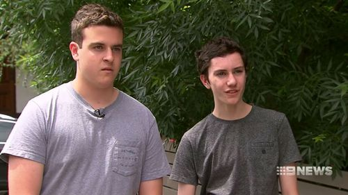 Ethan (left) shoved his friend Andrew (right) out of the way as the white Suzuki four-wheel drive approached them. (9NEWS)