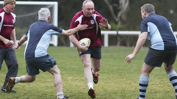 MPs play a friendly State of Origin match at Parliament House, Canberra