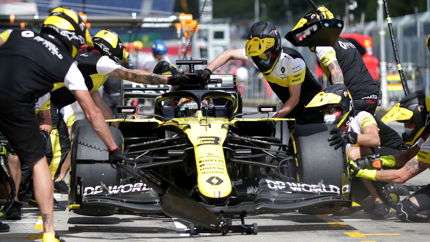 Daniel Ricciardo of Australia and Renault Sport F1 comes in for a tyre change