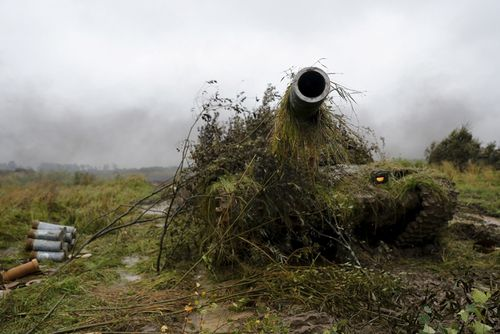 A tank is hidden during a military exercise at a training ground near Kaliningrad, Russia, last year. Picture: AP