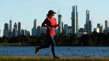 A jogger runs near Albert Park Lake in Melbourne, Australia.