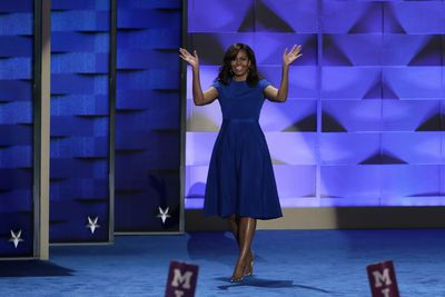 <p>A knee-length Christian Siriano dress was the First Lady's choice for the 2016 Democratic National Convention. With its cap sleeves and nipped-in waist the dress was a favourite - as were the metallic silver heels she paired with it.</p> Image: Getty.