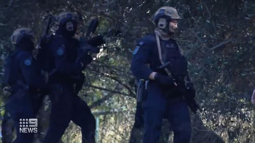 Manhunt underway after gun pointed at police in Sydney's west.