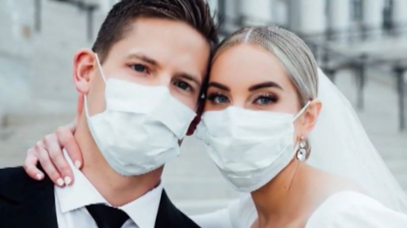US couple wear surgical masks in wedding photos