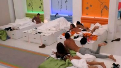 Yes, that mountain of bed sheets the Islanders are staring at... Malin and Terry are under there.