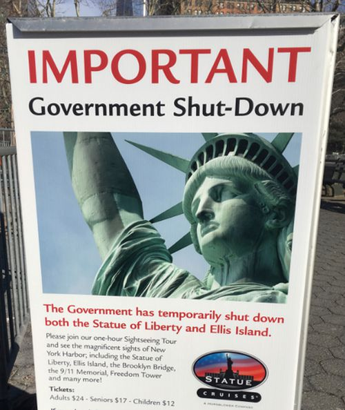 A sign at the Ellis Island ferry cue informed tourists of the shutdown's impact. (AAP)