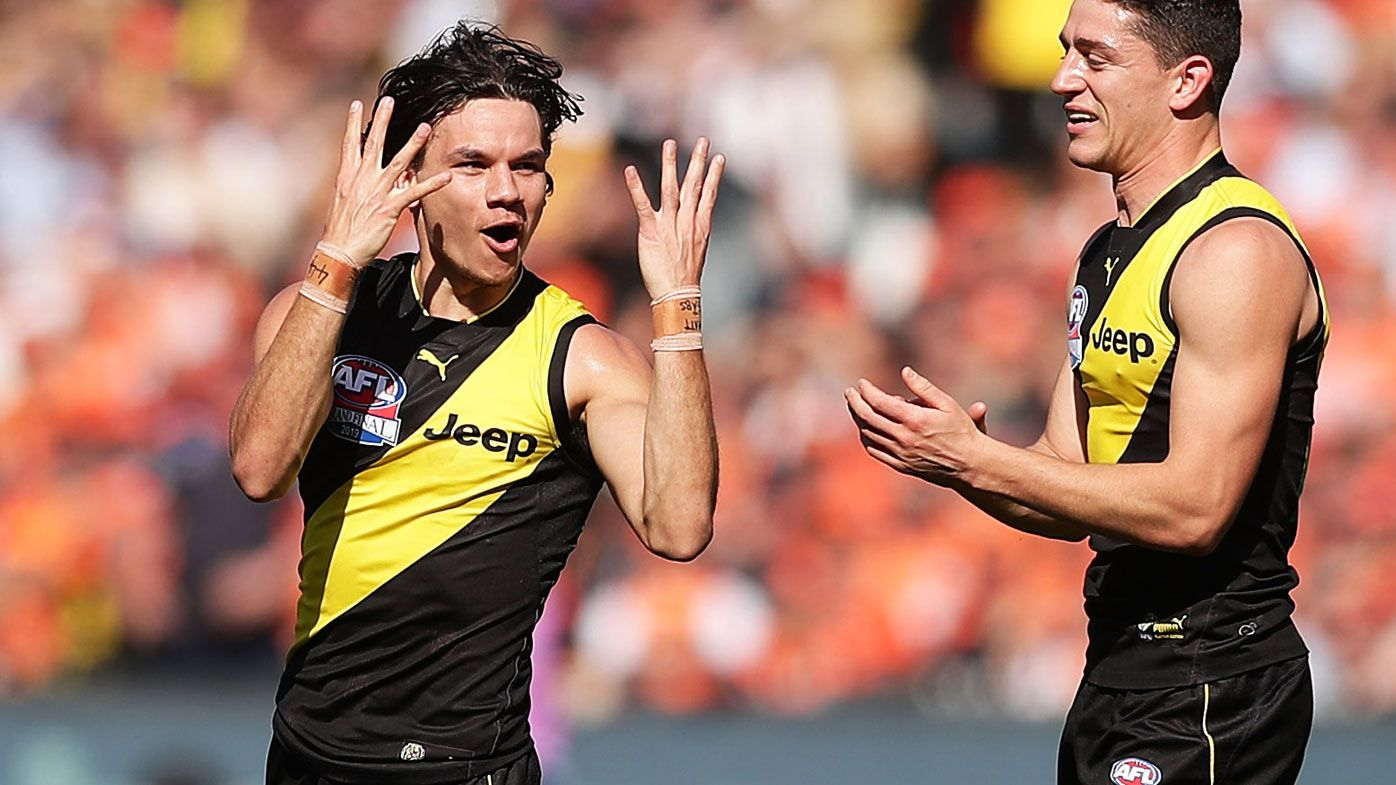 Daniel Rioli of the Tigers celebrates with team mates after kicking a goal during the 2019 AFL Grand Final