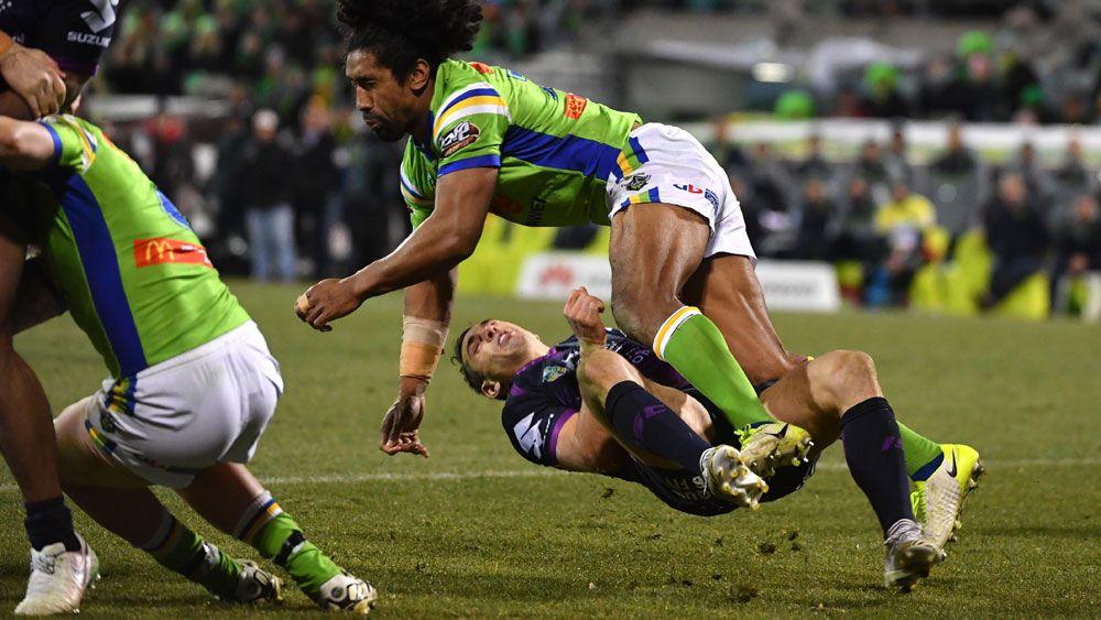 Sia Soliola flattens Billy Slater the last time the Raiders met the Storm. (AAP)