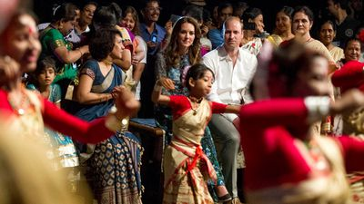 Kaziranga villagers join the royal couple to watch dancing as part of the Assamese Bihu festival, on day three of the tour.