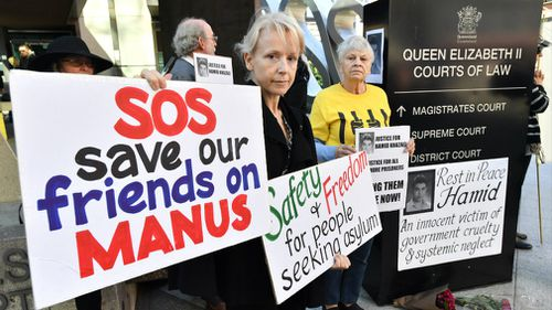 Protester Jillian Oldfield (left) from the Refugee Action Collective is seen during a vigil for deceased asylum seeker Hamid Khazaei outside the Brisbane Magistrates Court. Picture: AAP