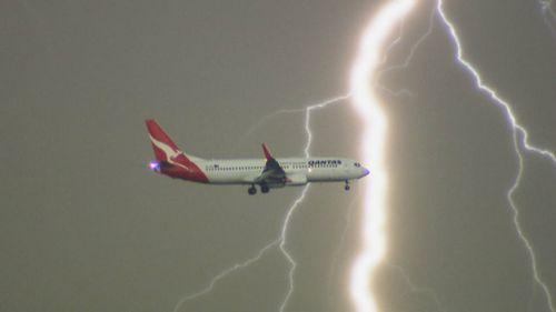 The lightning bolt strikes behind the plane. (Daniel Shaw)
