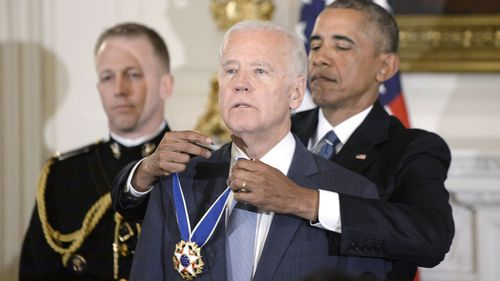 U.S. President Barack Obama (R) presents the Medal of Freedom to Vice-President Joe Biden during an event in the State Dining room of the White House, January 12, 2017 in Washington, DC