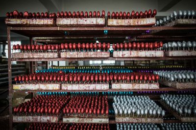 <p>Wei's father said the job is too tiring and that they probably won't do it again next year. Once they earn enough money for Wei to get married, they plan on returning home. </p><p> Pictured are Christmas decorations on the shelf after covered with red powder at a factory in Yiwu city.</p><p> </p>