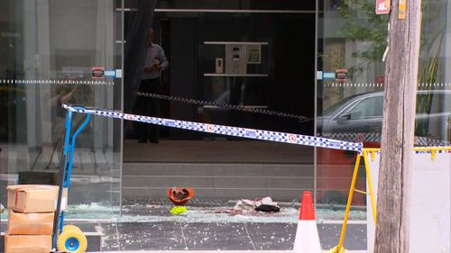 Two men have been injured after one fell through a glass ceiling at a Sydney construction site.