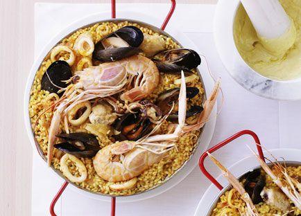Seafood paella with alioli