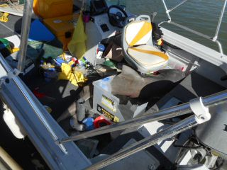 The small tinny was completely trashed when the enormous  bull shark jumped on board.
