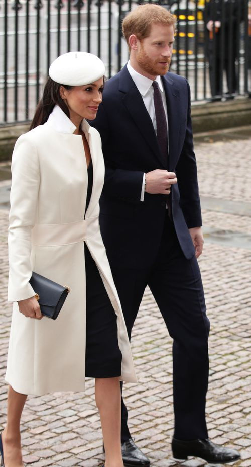 Meghan wore a cream coat and navy dress by Amanda Wakeley. Picture: PA/AAP