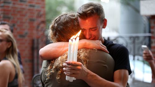 Mourners embrace during a candlelight vigil for those killed at the Pulse nightclub in Orlando, Florida. (AP)
