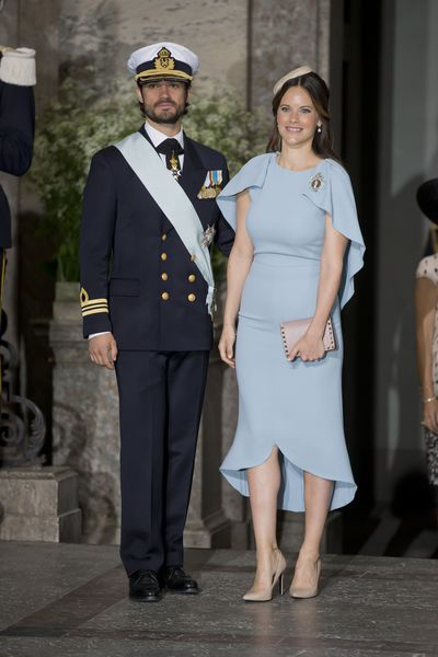 Prince Carl Philip of Sweden and Princess Sofia of Sweden, in Antonio Berardi, at the christening of Prince Oscar of Sweden in Stockholm, May 27, 2016