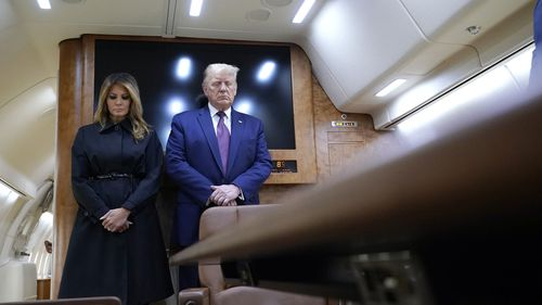 President Donald Trump and first lady Melania Trump pause for a moment of silence on Air Force One as he arrives at the airport in Johnstown, Pa., on his way to speak at the Flight 93 National Memorial, Friday, Sept. 11, 2020, in Shanksville, Pa